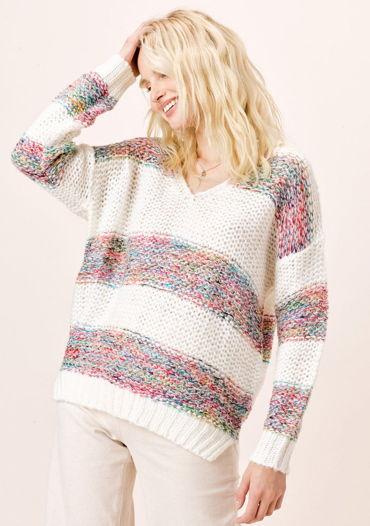 [Color: OffWhite/Multi] Lighten up your day and stay cozy in this beautiful loose knit white sweater with multi color rainbow yarn stripes, featuring a cute v neckline and ribbed hem. It is a spring and summer closet staple for breezy days.