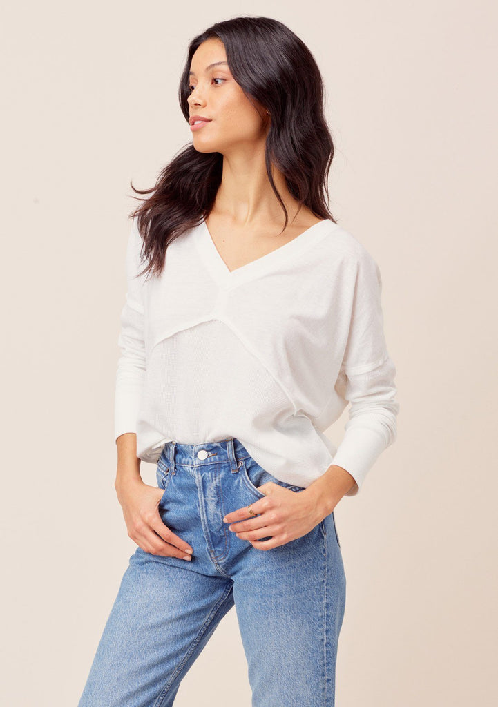 [Color: White] Long sleeve v neck thermal. Features waffle knit details and a dropped shoulder.