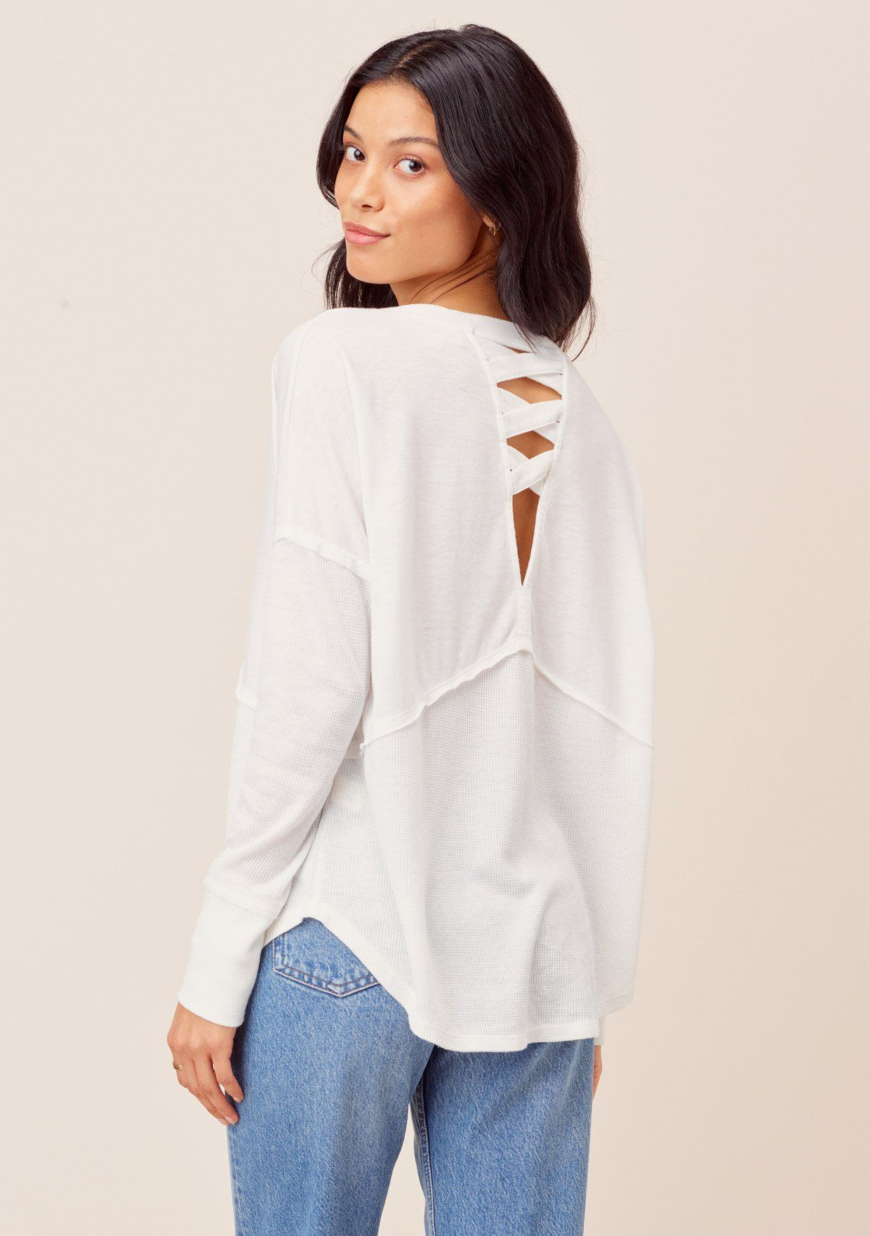 [Color: White] Long sleeve v neck thermal. Features a peek a boo back detail.