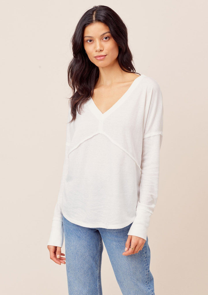 [Color: White] Long sleeve v neck thermal. Features exposed seam detail.