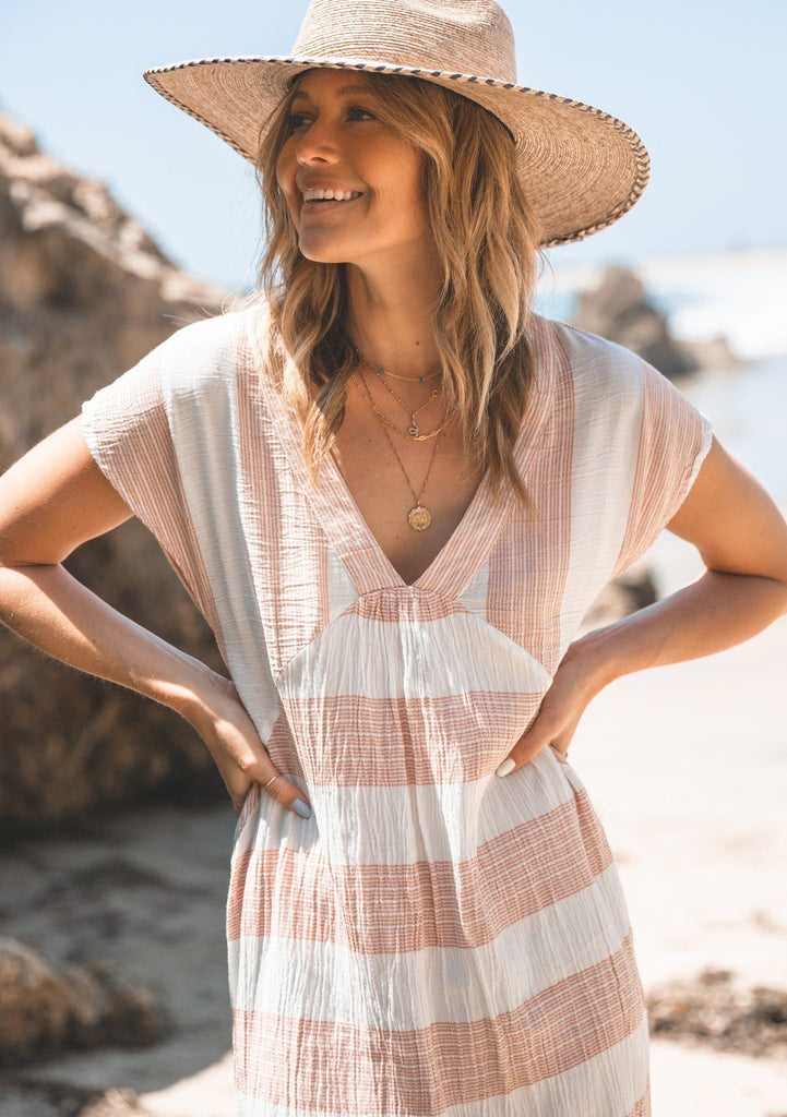[Color: Rust/White] Lovestitch white linen bohemian chic beach dress swimsuit cover up with pretty subtle red stripes, a deep v-neckline and flattering cap sleeves. The perfect mid-length lightweight dress for summer days