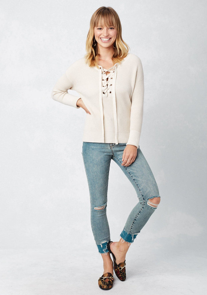 [Color: Bone] Lovestitch long sleeve, scoop neck, waffle knit sweater with lace-up front detail.