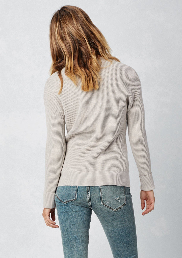 [Color: Heather Stone] Lovestitch long sleeve, scoop neck, waffle knit sweater with lace-up front detail.