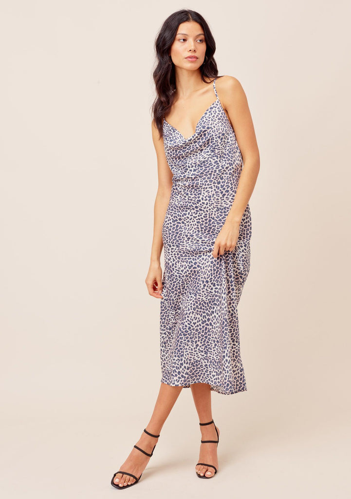 [Color: Natural/Midnight] Lovestitch natural/midnight Bias cut, midi slip dress in an elegant leopard print with sexy cowl neck and criss-cross back detail.