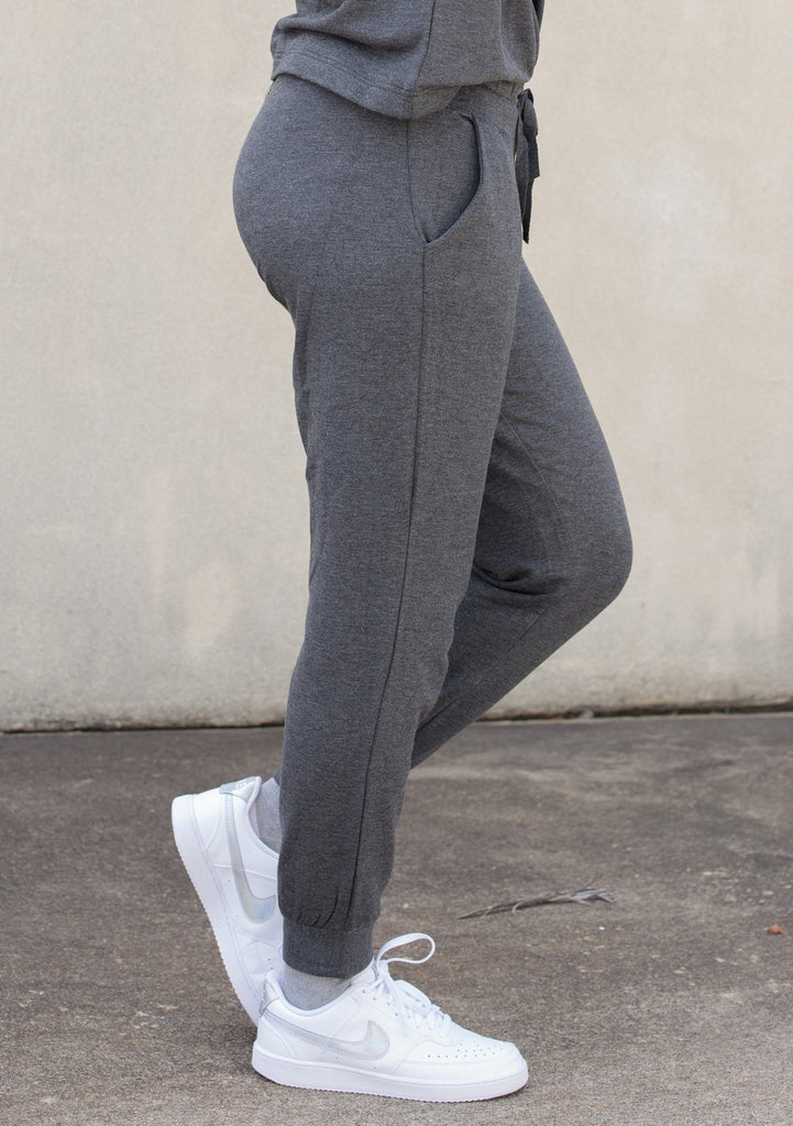 [Color: Dark Heather Grey] An incredibly soft classic fit jogger. Featuring a drawstring waist, seamed yoke detail, and essential side pockets. Paired here with matching sweatshirt.
