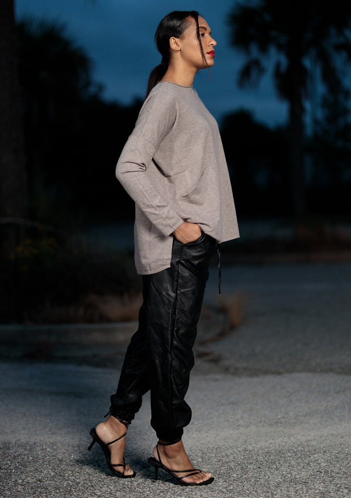 [Color: Heather Coco] A soft knit pocket pullover, featuring breezy side vents, an effortlessly chic rolled crew neckline, and two side pockets. Paired here with black trousers.