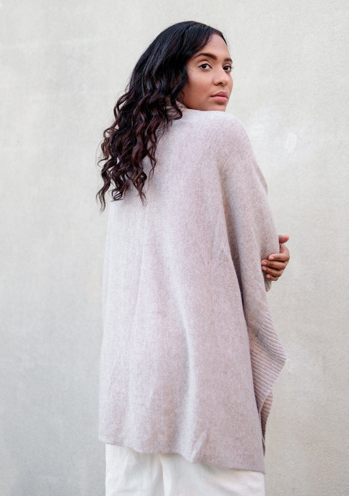 [Color: Heather Mushroom] Super soft knit sweater poncho. Featuring a shawl collar neckline with functional shank buttons, a front kangaroo pocket, and contrast ribbed trim.