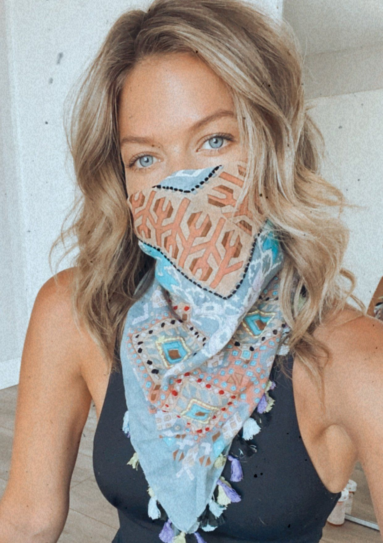[Color: Grey] Keep your bohemian flair with this beautifully detailed scarf that doubles over as a face mask. A mix of purples, blues, grays, and tassels add an eclectic quality to this functional and versatile statement piece. Make this scarf a part of your day to day boho style! Stay safe and protect those around you.