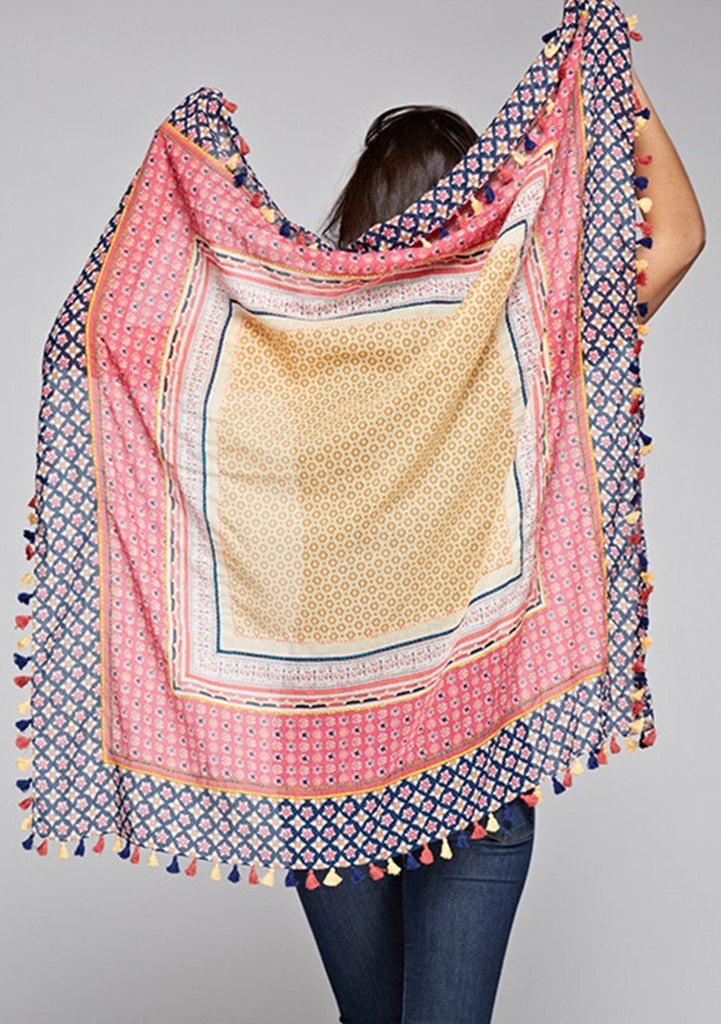 [Color: Pink Red] Keep your bohemian flair with this beautifully detailed scarf that doubles over as a face mask. A mix of pinks, blues, reds, and tassels add an eclectic quality to this functional and versatile statement piece. Make this scarf a part of your day to day boho style! Stay safe and protect those around you.