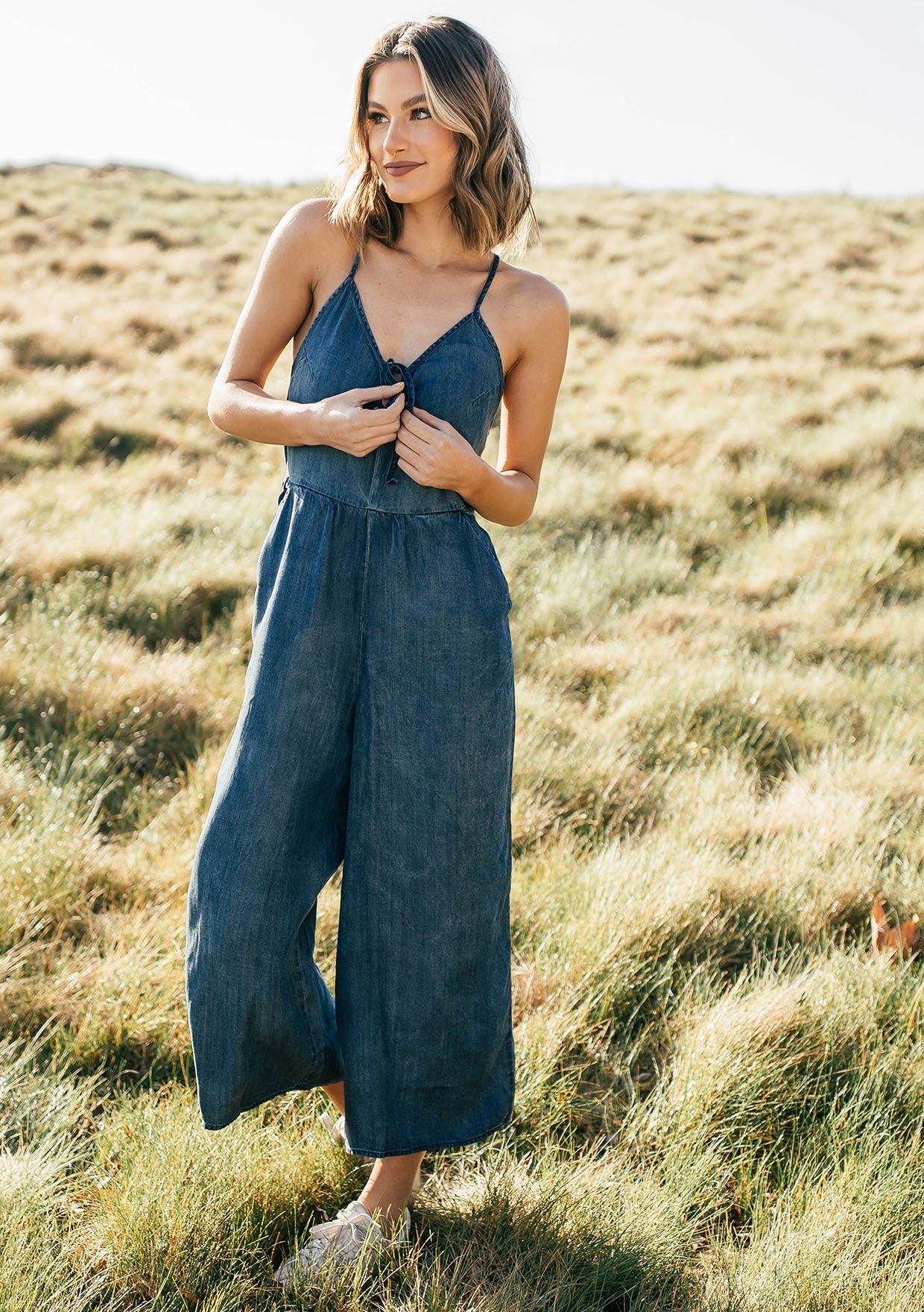 [Color: Dark Wash] Lovestitch lightweight, cropped gaucho wide leg tencel jumpsuit featuring keyhole tie front detail, criss-cross strappy back, adjustable skinny straps and side pockets.