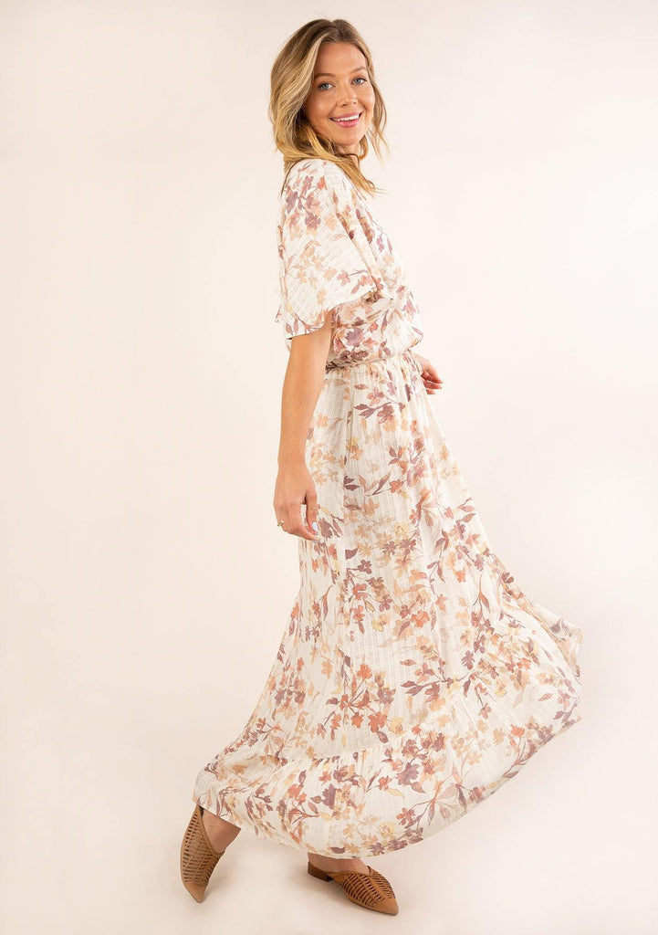 [Color: Peach Ivory] Beautiful and ultra feminine maxi dress featuring half length flutter sleeve and flirty ruffle hem. Soft and pretty floral print.