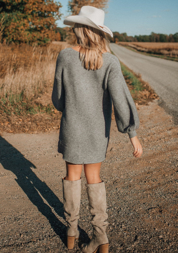 [Color: Heather Charcoal] A super soft ribbed sweater dress. A voluminous lantern sleeve and v neckline add interest to this warm and comfortable style. Styled here with suede knee high boots.
