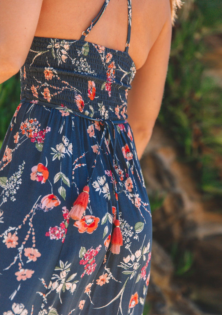 [Color: Navy/Poppy] Lovestitch beautiful navy blue maxi dress with pretty and elegant poppy floral print, a tiered pixie hem, strappy crosscross back, featuring a classic smocked top and tassel tie belted waist