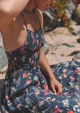 [Color: Navy/Poppy] Lovestitch beautiful navy blue maxi dress with pretty and elegant poppy floral print, a tiered pixie hem, strappy crosscross back, featuring a classic smocked top.
