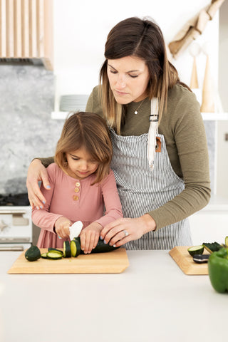 Mom and daughter prep food for dinner