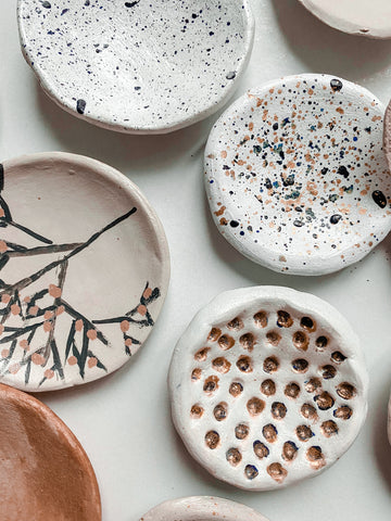 Air-dry clay pieces with sealant applied