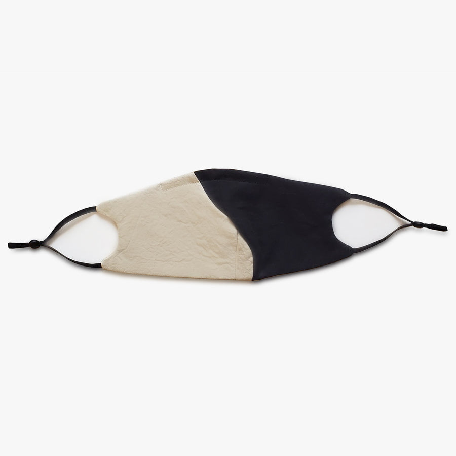 SERA GHADAKI unisex cotton masks with yin yang curved contour detail and adjustable straps. Sustainably made to order.