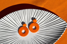 Load image into Gallery viewer, Handmade bold colourful orange 60s style circle earrings.