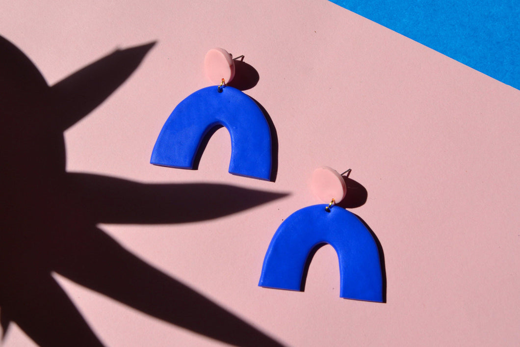 Clip on Clay statement earrings. Blue arches handmade earrings with pink studs, made in Bristol UK by Sophie Filomena.