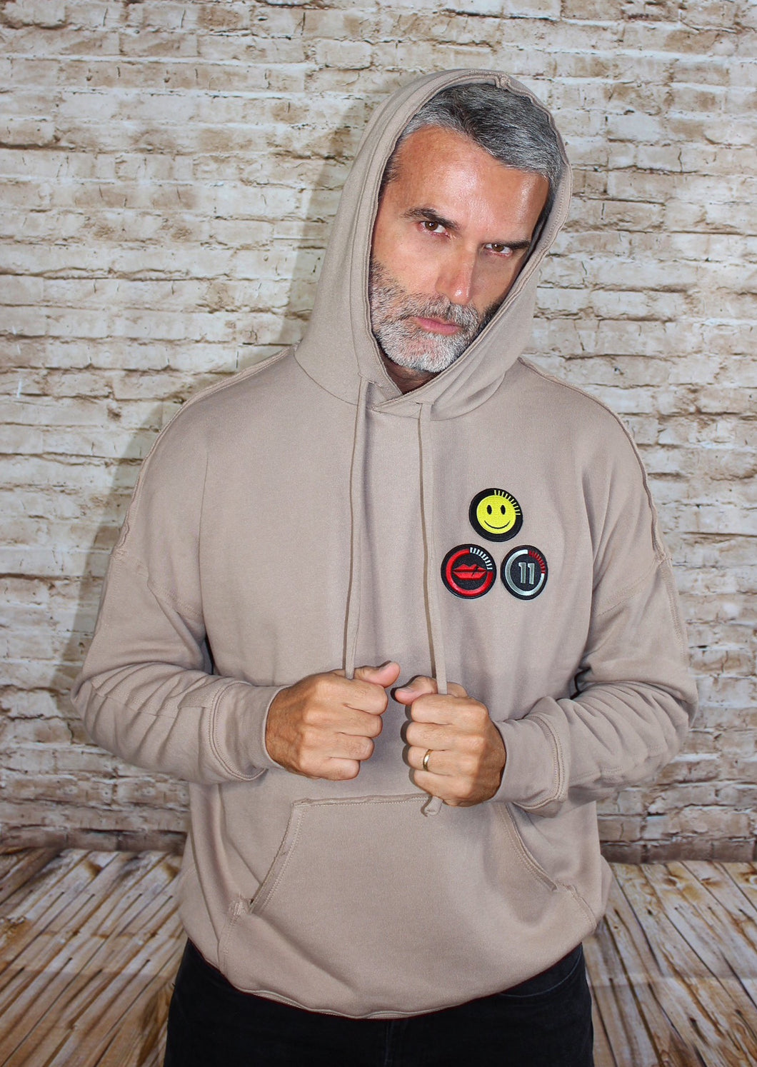 This new happy face hoodie offers a casual, relaxed fit for everyday wear. Oversized fit. Raw seams at shoulders and pocket. Oversized kangaroo pocked. 52% Airlume combed and ring-spun cotton, 48% poly fleece.  Edit alt text