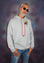 Load image into Gallery viewer, This new happy face grey hoodie offers a casual, relaxed fit for everyday wear.  Oversized fit. Raw seams at shoulders and pocket. Oversized kangaroo pocked.  52% Airlume combed and ring-spun cotton, 48% poly fleece.