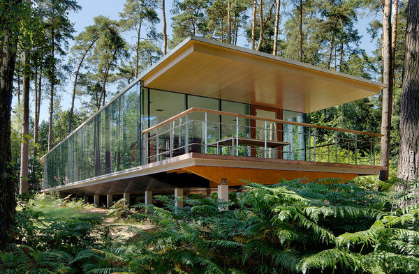 House in the woods with complete glass exterior