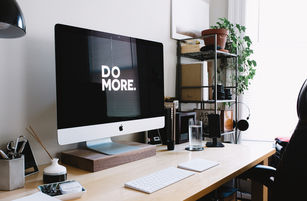 """Digital work-from-home workspace that says """"Do More"""" on screen."""