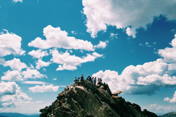 Group of friends at the top of a mountain