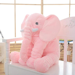 a pink teddy bear sitting on a pink table