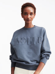 Model wearing stone sweatshirt