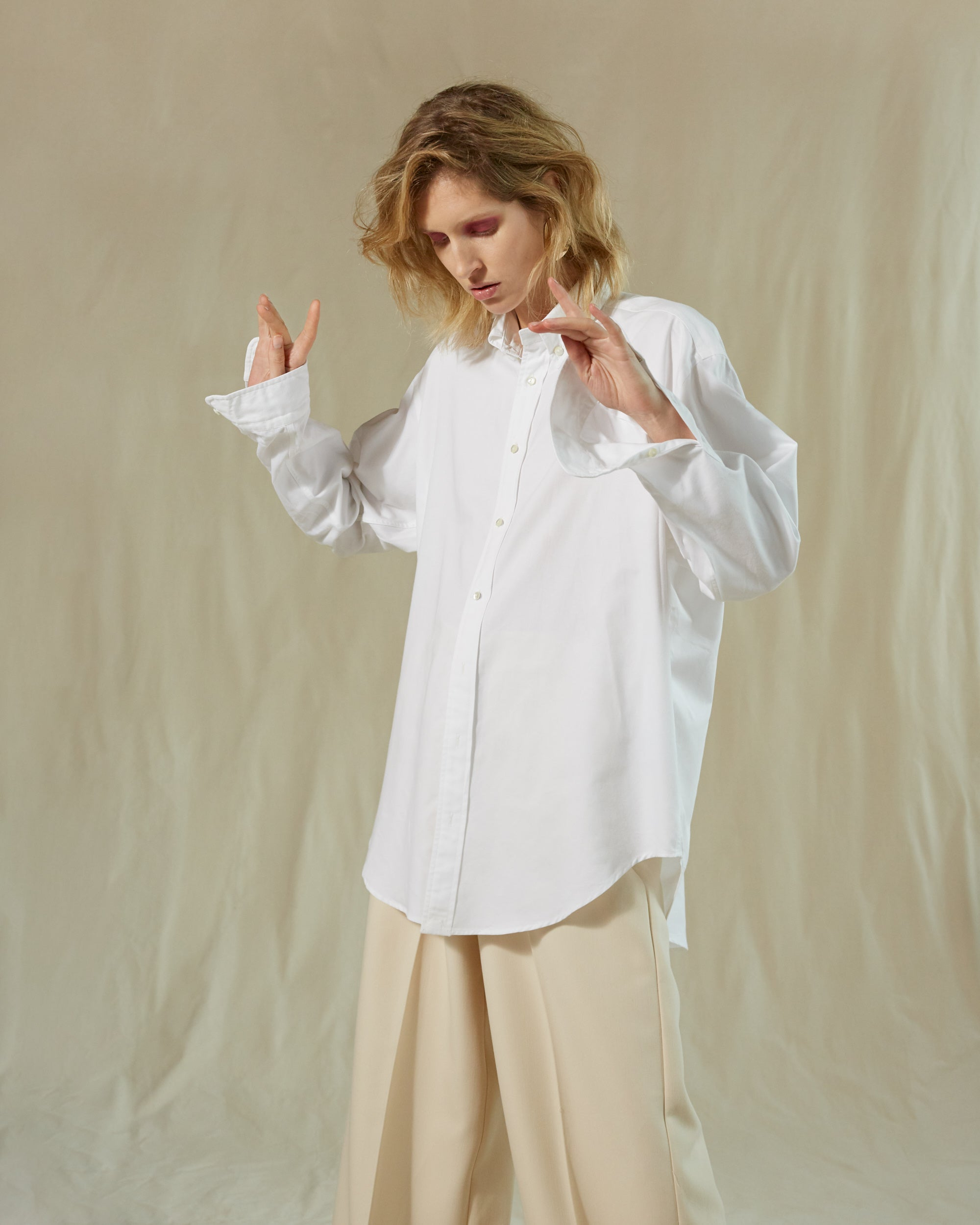 Conscious Collective shirt 100% upcycled hotel linen Archivist Studio white model dancing