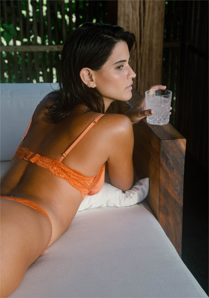 Jade panty Icone Lingerie Conscious collective model bed orange
