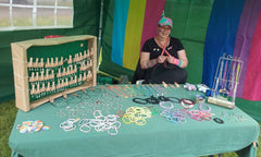 Charley making items at the stall
