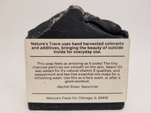 Load image into Gallery viewer, Charcoal Sea Salt Label Describing soap's qualities and peppermint and tee tree scent