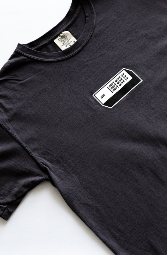 DON'T GIVE UP STICKER Cotton Tee in Graphite by RISE