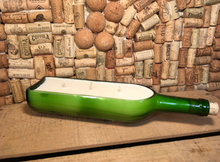Load image into Gallery viewer, Recycled green glass wine bottle with scented soy candle has glass footed bottom and comes in two scents, forest floor and sweet basil bergamot