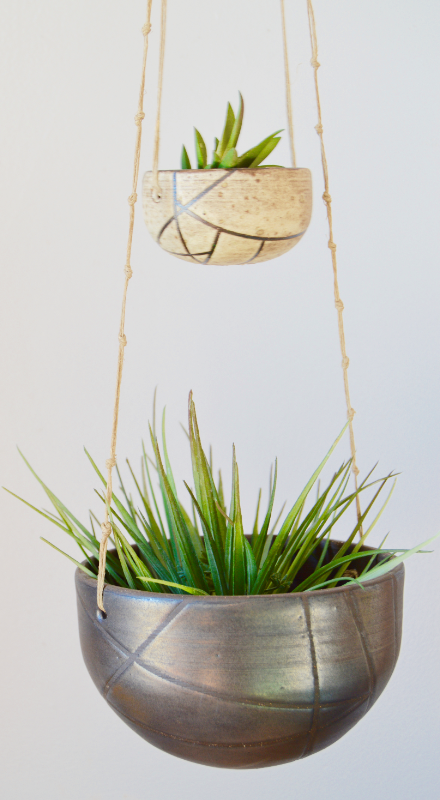 Double hanging ceramic planters in natural colored glazes, a creamy salt and a blackened gold
