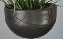 Load image into Gallery viewer, Detail of Double hanging ceramic planters in natural colored glazes, a creamy salt and a blackened gold