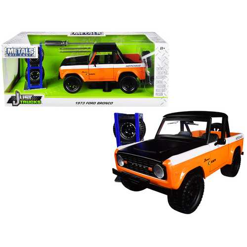 "1973 Ford Bronco Metallic Orange and Matt Black ""KC HiLiTES"" with Extra Wheels ""Just Trucks"" Series F977-31058"