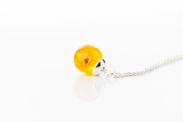 Real buttercup sterling silver resin sphere necklace