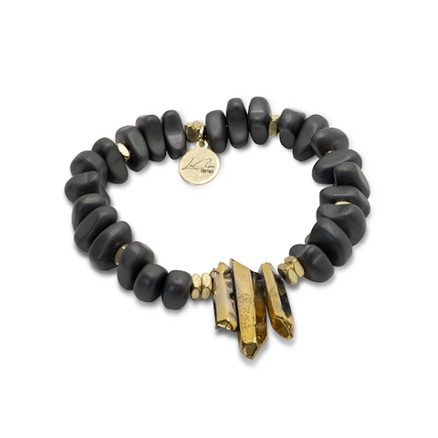 The gold and black Statement Bracelet designed and handcrafted by the jewelry artisans at LaCkore Couture.