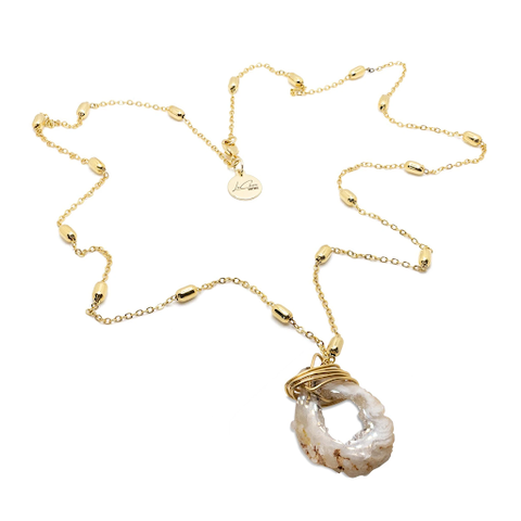 The gold Crystal Goddess Necklace designed and handcrafted by the artisans at LaCkore Couture.