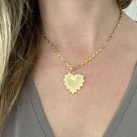 A woman wearing the Heart Throb Necklace designed and handcrafted by the artisans at LaCkore Couture
