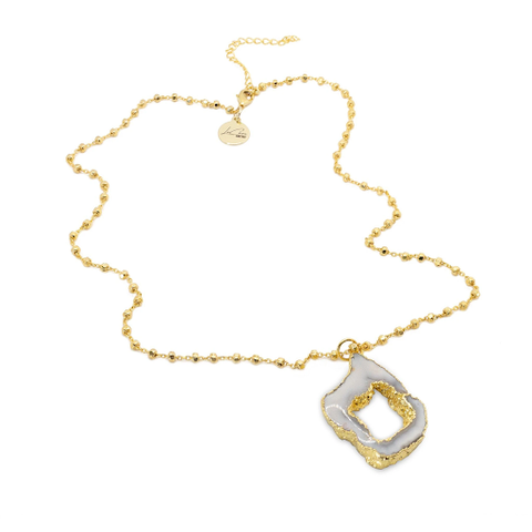 The gold Heavenly Drop Necklace designed and handcrafted by the artisans at LaCkore Couture.