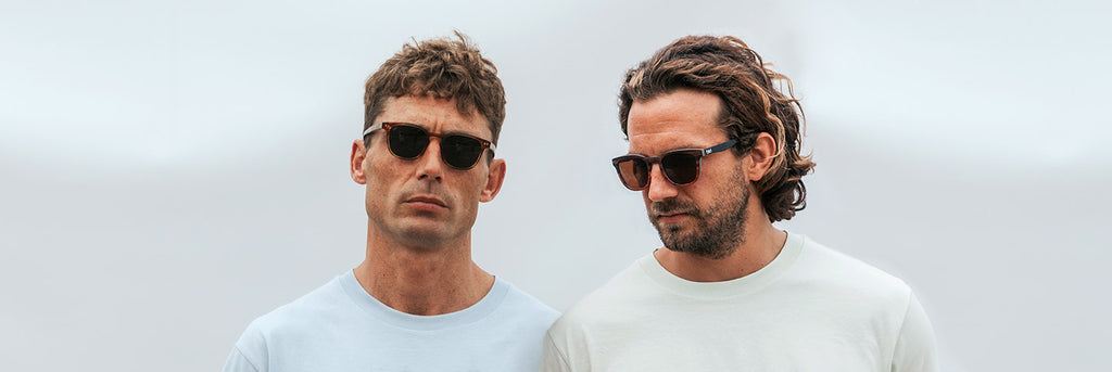 Man wearing eco-friendly sunglasses made from bio-acetate and sustainable wood