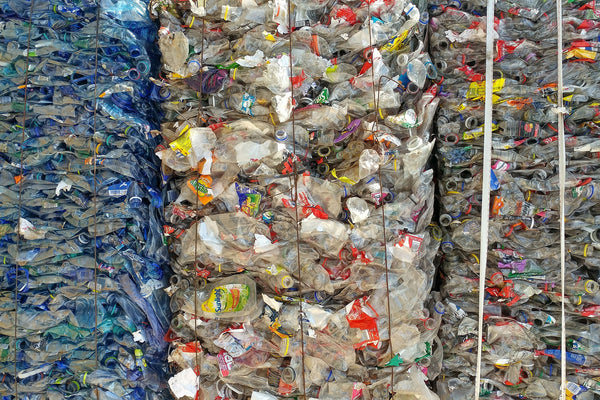 A wall of used bottles for recycling