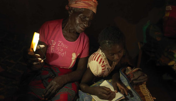 Women and child using solar light