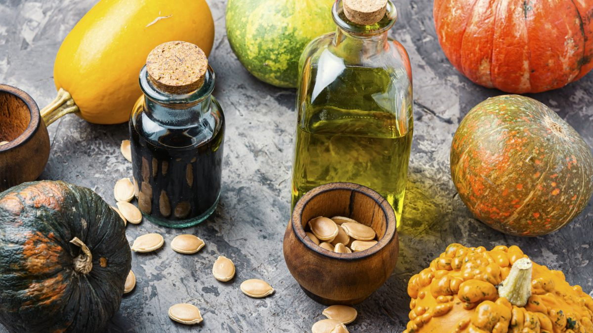Pumpkins, pumpkin seeds and pumpkin seed oil in glass bottles