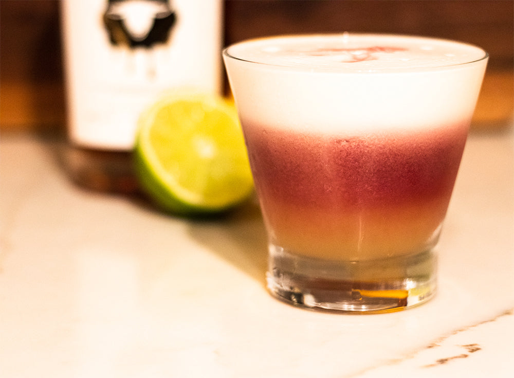 Sour Skrew Cocktail with Skrewball, lime, and egg white