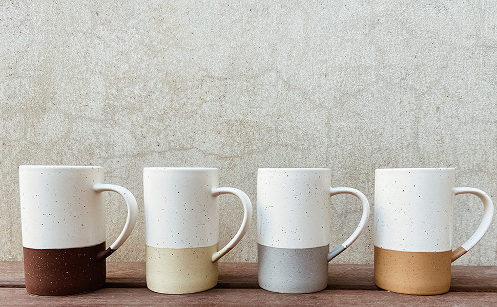 set of four coffee mugs in different neutral colors